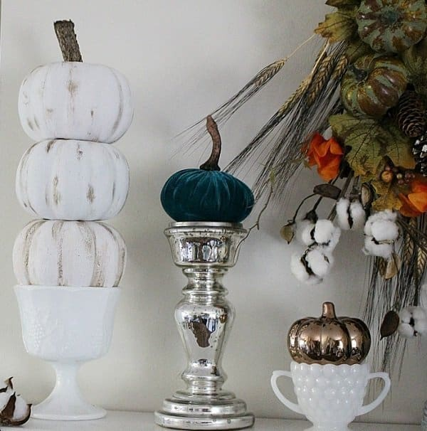 DIY Dollar store pumpkin fall decorating ideas. This is the best DIY Fal decorating ideas for the porch. Outdoor Fall Decorating ideas for your porch and beyond. Easy fall decorating ideas for your front porch. Lots of simple and inexpensive ideas to help you decorate your home for fall. #falldecor #falldecorations #fallonabudget #homedecorideas